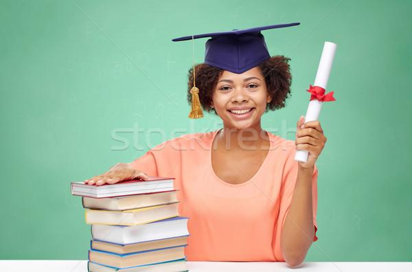 Mutlu Afrika bekâr kız kitaplar diploma Stok fotoğraf © dolgachov