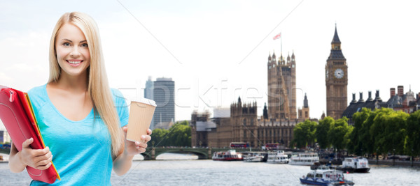 smiling student girl with folders and coffee cup Stock photo © dolgachov