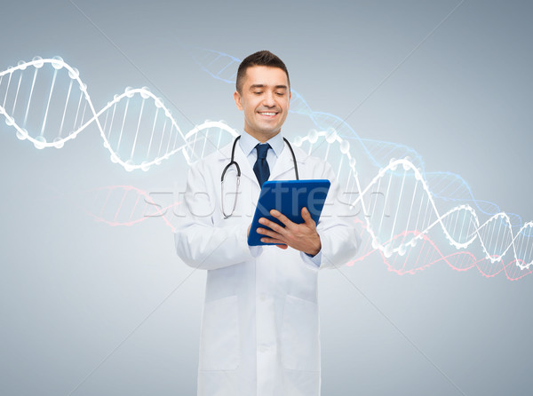 happy male doctor with tablet pc and dna molecule Stock photo © dolgachov