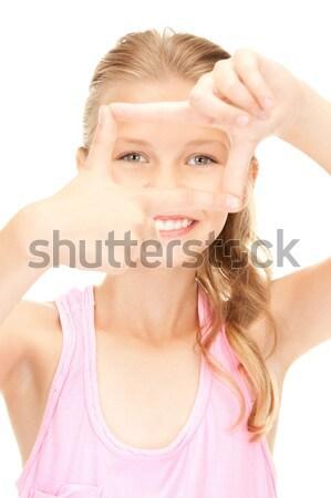 Meglepődött lány fényes kép fehér kezek Stock fotó © dolgachov