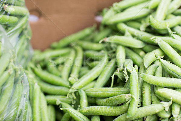 close up of green peas in box at street market Stock photo © dolgachov