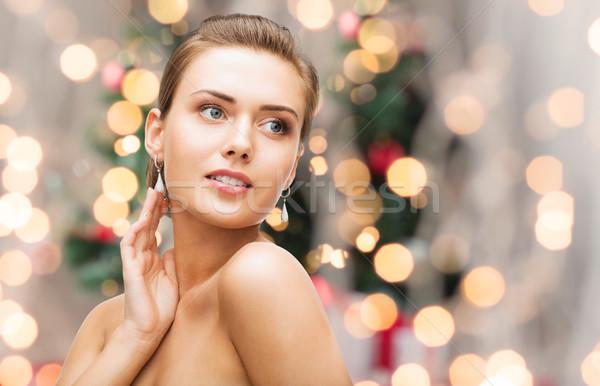 beautiful woman with diamond earrings and bracelet Stock photo © dolgachov