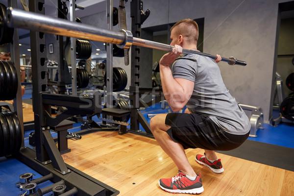 ストックフォト: 若い男 · 筋肉 · バー · ジム · スポーツ · フィットネス