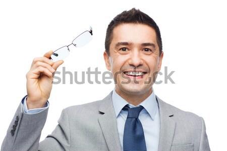 happy businessman in eyeglasses showing thumbs up Stock photo © dolgachov