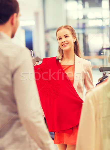 happy young couple choosing clothes in mall Stock photo © dolgachov
