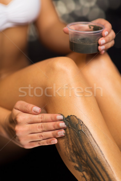 close up of woman applying therapeutic mud in spa Stock photo © dolgachov