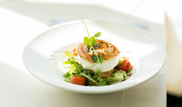 close up of halloumi cheese salad at restaurant Stock photo © dolgachov