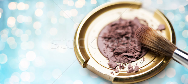 close up of makeup brush and eyeshadow over lights Stock photo © dolgachov