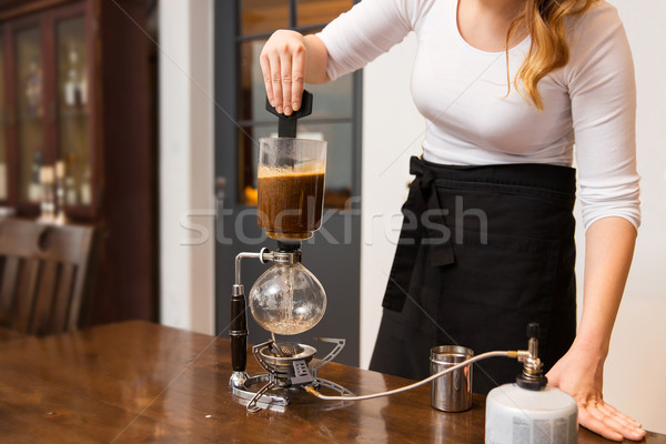 close up of woman with siphon coffee maker at shop Stock photo © dolgachov