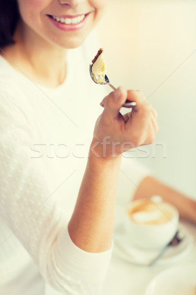close up of woman eating cake at cafe or home Stock photo © dolgachov