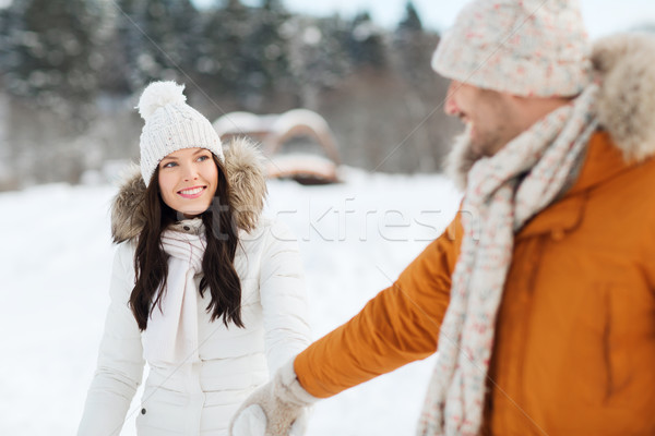 happy couple walking along snowy winter field Stock photo © dolgachov