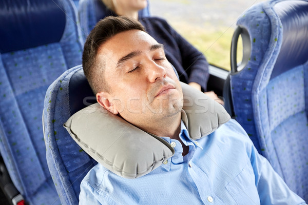 man sleeping in travel bus with cervical pillow Stock photo © dolgachov