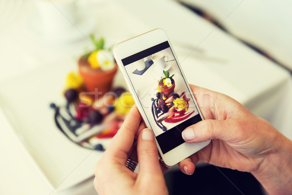 close up of woman picturing food by smartphone Stock photo © dolgachov