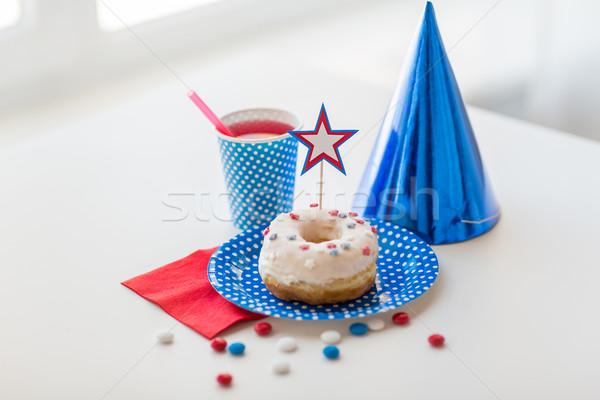 Fánk dzsúz cukorkák nap amerikai ünneplés Stock fotó © dolgachov