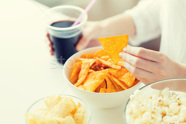 close up of woman with junk food and coca cola cup Stock photo © dolgachov