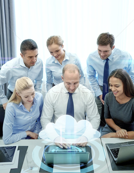 smiling business people with laptop in office Stock photo © dolgachov