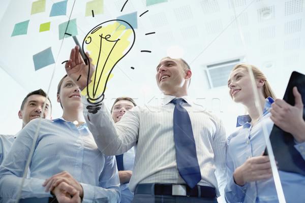 Sonriendo gente de negocios marcador pegatinas trabajo en equipo planificación Foto stock © dolgachov