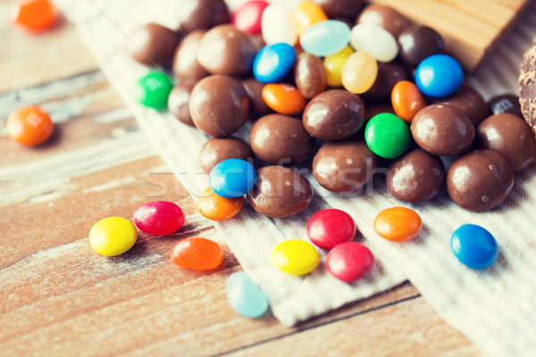 close up of jelly beans and chocolate candies Stock photo © dolgachov