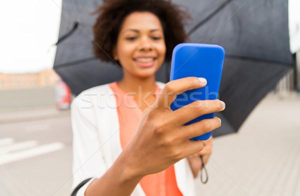 Kadın şemsiye iş kötü hava Stok fotoğraf © dolgachov