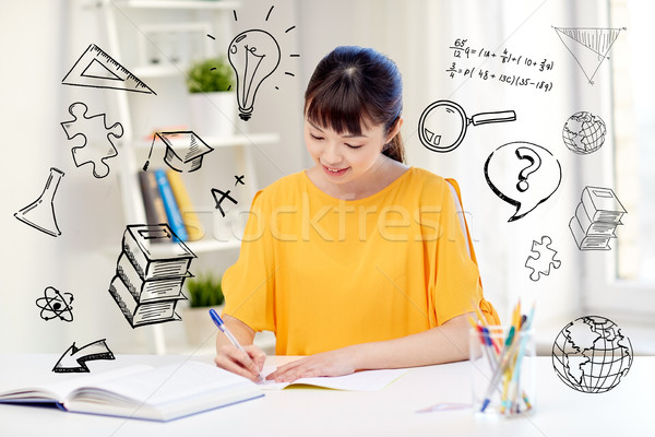 happy asian young woman student learning at home Stock photo © dolgachov