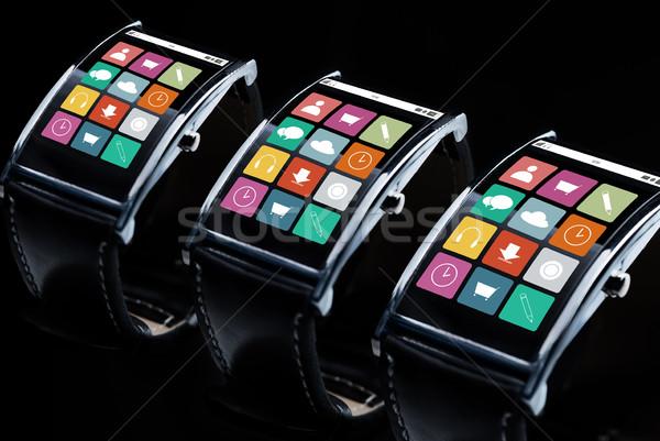 close up of smart watch set with menu icons Stock photo © dolgachov