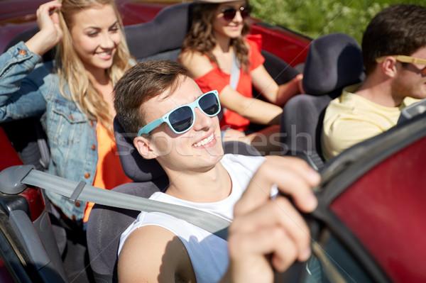 Mutlu arkadaşlar sürücü kabriyole araba boş Stok fotoğraf © dolgachov