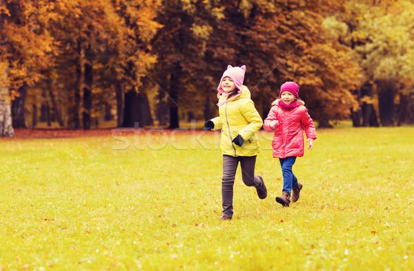 group of happy little girls running outdoors Stock photo © dolgachov