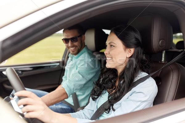 Felice uomo donna guida auto tempo libero Foto d'archivio © dolgachov