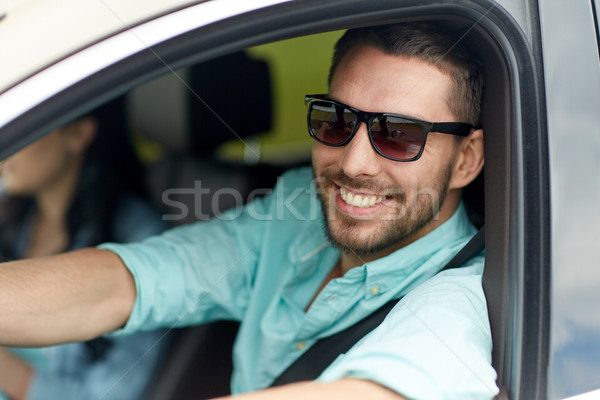 happy smiling man in sunglasses driving car Stock photo © dolgachov