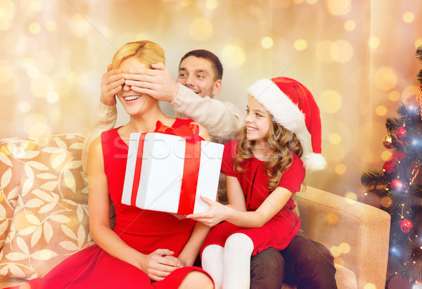 father and daughter surprise mother with gift box Stock photo © dolgachov