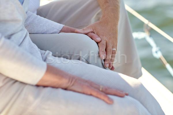 Közelkép idős pár vitorla csónak jacht vitorlázik Stock fotó © dolgachov