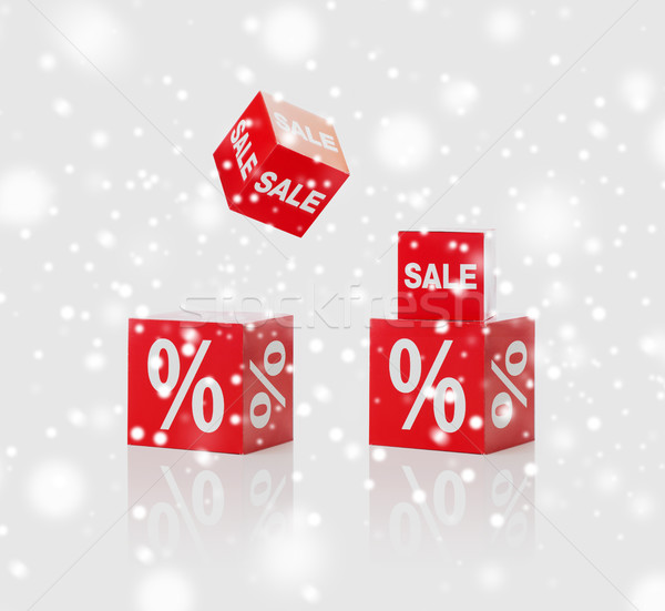 red boxes with sale and percent sign over snow Stock photo © dolgachov