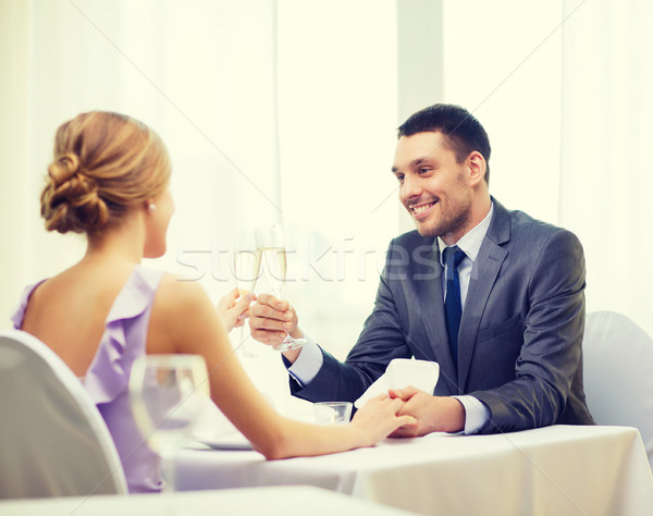 couple with glasses of champagne at restaurant Stock photo © dolgachov