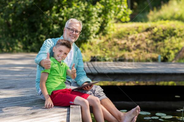деда мальчика реке семьи поколение Сток-фото © dolgachov