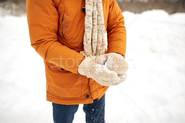 close up of man with snowball in winter Stock photo © dolgachov