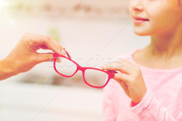 девушки очки оптика магазине Сток-фото © dolgachov