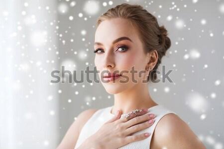 Mooie vrouw ring oorbel christmas vakantie Stockfoto © dolgachov