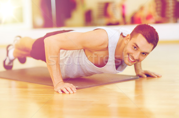 улыбаясь человека спортзал фитнес спорт Сток-фото © dolgachov