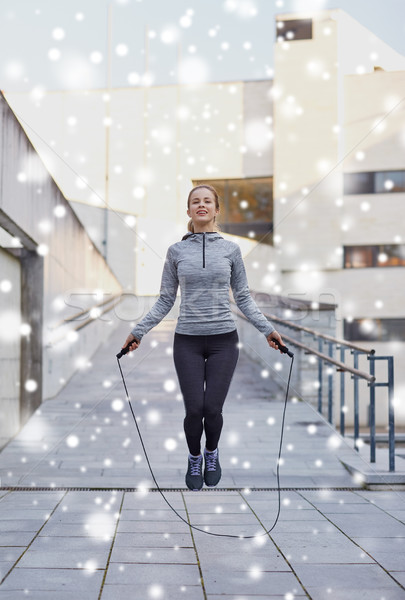 happy woman exercising with jump-rope outdoors Stock photo © dolgachov