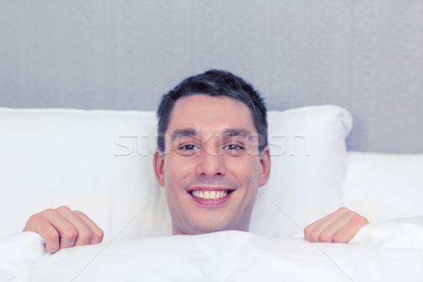 handsome sleeping in bed Stock photo © dolgachov