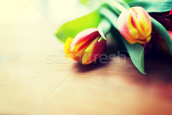 close up of tulip flowers on wooden table Stock photo © dolgachov