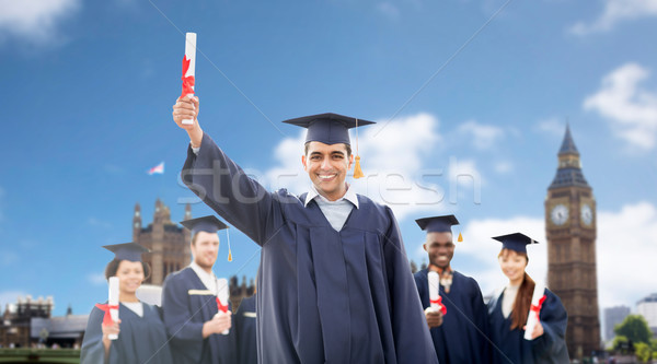 happy students in mortarboards with diplomas Stock photo © dolgachov