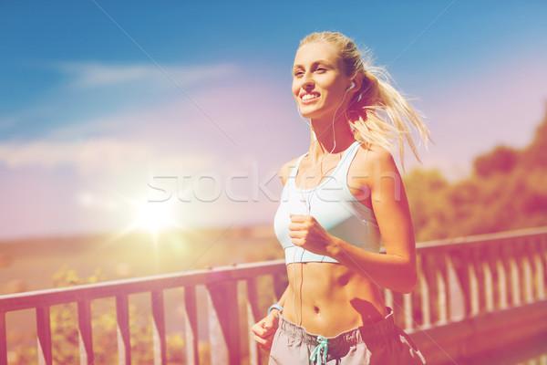 Mosolyog fiatal nő fut kint fitnessz sport Stock fotó © dolgachov