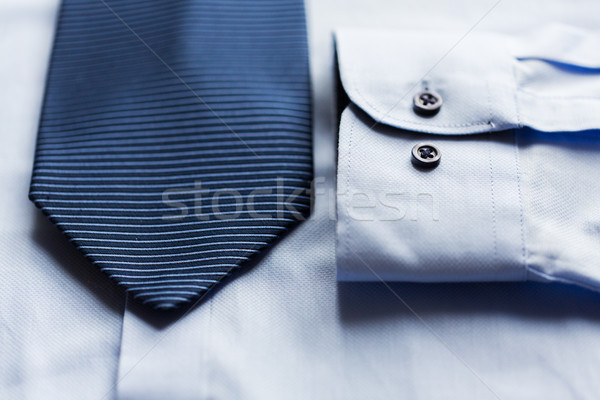 close up of shirt and blue patterned tie Stock photo © dolgachov