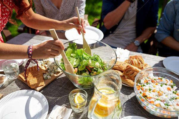 friends having dinner at summer garden party Stock photo © dolgachov
