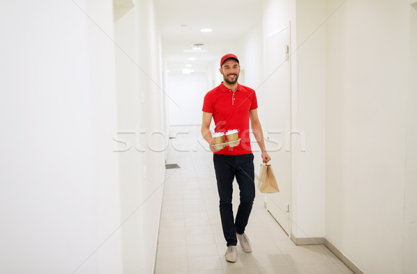 man delivering coffee and food to customer home Stock photo © dolgachov