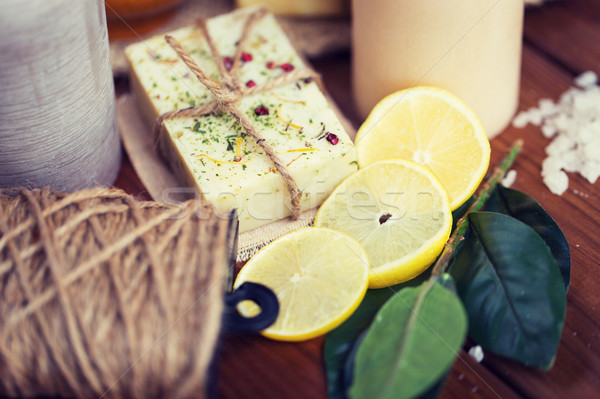 close up of natural soap and candles on wood Stock photo © dolgachov