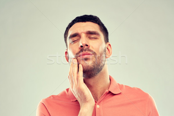 unhappy man suffering from toothache Stock photo © dolgachov