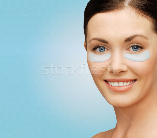 Stock photo: close up of woman face with under-eye patches