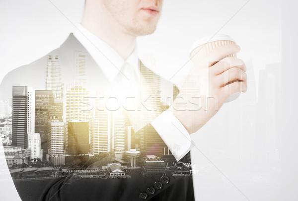 close up of businessman drinking take away coffee Stock photo © dolgachov